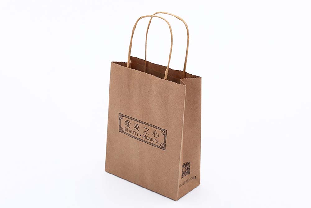 This Brown Kraft Paper Bag Consist Of Strong And String Handle Fit For Large Quany Producing At Low Price