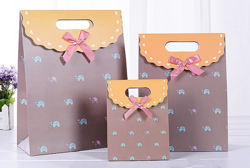 paper bag decoration with ribbon knot