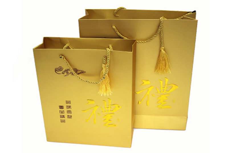 gold colored paper carrier bags