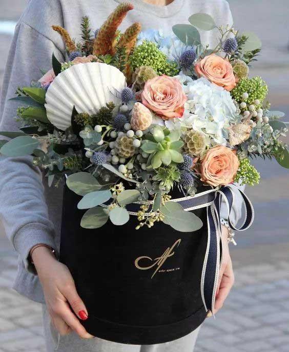 black paper flower box with round hat